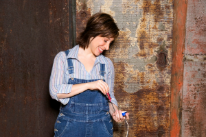 Woman adjusting plug